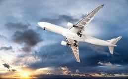Airplane transportation. Jet air plane. Flies in blue sky Stock Image