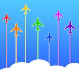 Airplane travel. Rainbow color airplanes flying off to travel and business destinations Royalty Free Stock Photography