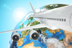Airplane travel background. Airliner and earth. Royalty Free Stock Photo