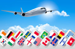 Airplane travel background with flags of different countries. Stock Photos