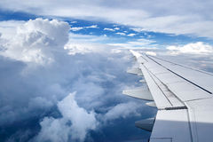 Airplane travel. In clouds Royalty Free Stock Photography