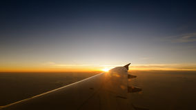 Airplane travel sunset time Stock Photography