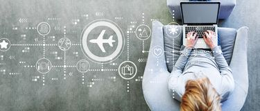 Airplane travel theme with man using a laptop. In a modern gray chair royalty free stock images