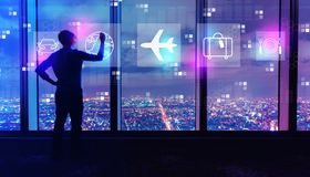 Airplane travel theme with man by large windows at night royalty free stock photos