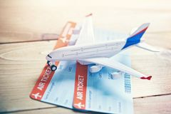 Airplane traveling and tickets booking concept. Plane model with tickets as airplane traveling and tickets booking concept stock photography