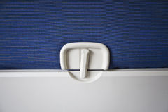 Airplane Tray Table. Close-up of latch and tray Stock Photo