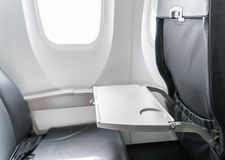 Airplane tray table on seat back . Stock Photos