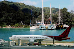 Airplane on tropical destination. Stock Photos