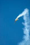 Airplane in trouble. An airplane in trouble flying down to earth with lots of smoke Stock Photo