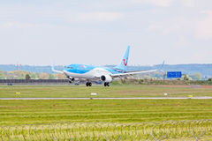 Airplane from TUIfly on landing approach, airport Stuttgart, Germany Royalty Free Stock Photography