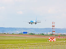 Airplane from TUIfly on landing approach, airport Stuttgart, Germany Royalty Free Stock Photos