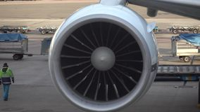 Airplane turbine. Spinning blades are moving. Shot in 4k. airport life stock footage