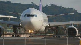 Airplane turn to executive start on runway. PHUKET, THAILAND - NOVEMBER 26, 2015: Thai Airways Airbus 330 HS-TEO named Chutamat turn to executive start on the stock video