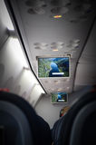 Airplane tv screens. TV screens displaying images during the flight Royalty Free Stock Photography