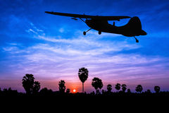 Airplane on twilight time Royalty Free Stock Photography