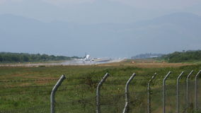 Airplane with two engines landing on runway stock video