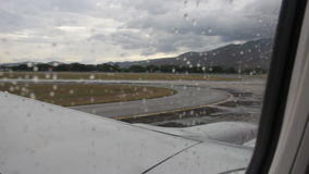 Airplane u-turn on runway in rainy day stock footage