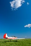 Airplane under blue skies. Red and white airplane under blue skies Stock Photography