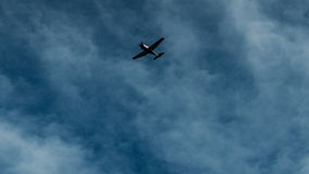 Airplane Under Cloudy Sky Stock Photo
