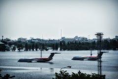 Airplane under flood Royalty Free Stock Photo