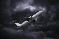 Airplane under stormy sky Stock Photos