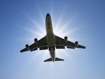 Airplane under sunlight Stock Images