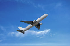 Airplane under white cloud on blue sky Royalty Free Stock Photography