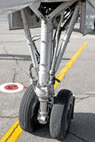 Airplane undercarriage. Closeup of airplane undercarriage or landing gear with yellow marking line Stock Photo