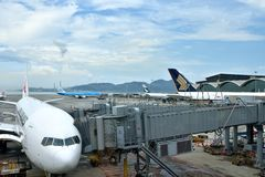 Airplane is unloading in Hongkong Airport Royalty Free Stock Images