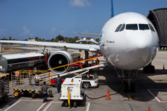 Airplane Unloading the Luggages at the Airport Stock Photo