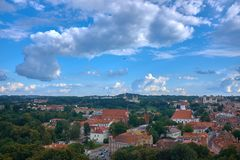 Airplane upper the Vilnius city on cloudy day royalty free stock photo