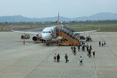 An airplane of Vietjet Air catching passengers Stock Images