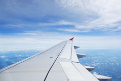 Airplane view. Travel view from airplane showing wing during flight over thailand royalty free stock photography