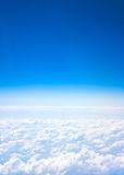 Airplane view. Background abstract: blue sky and clouds Stock Photography