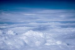 Airplane view above the clouds. In a suuny day stock photos