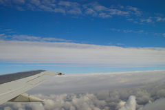 Airplane view on cloud layers. View from an airplane at 30.000 feet on two layers of clouds in the atmosphere royalty free stock images