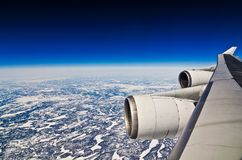 Airplane view on frozen Canada of sky with engine of airplane royalty free stock photos