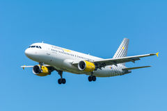 Airplane Vueling EC-LLJ Airbus A320-200 is flying to the runway. Royalty Free Stock Images