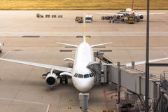 Airplane Waiting Idle on Runway Traveling Airport Outdoors Vehicles Bright Skies stock images