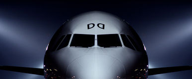 Airplane waiting to take off. Night scene Stock Photos