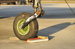 Airplane Wheel. Small aircraft front rusted wheel stock photography