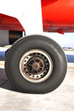 Airplane wheel. Driving front wheel with landing lights from Airbus 320 Stock Image