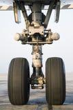 Airplane wheel close-up Stock Photos