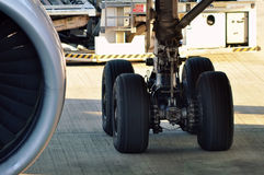 Airplane whell. Left wheel of airbus 330 airplane on ground. Photo was taken from departure gate at late evening Royalty Free Stock Photo