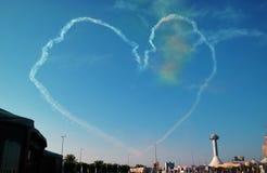 Airplane white smoke heart Royalty Free Stock Photography