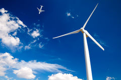 Airplane and Wind turbine Stock Photos