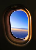 Airplane Window. Look out from a window inside an air plane during sunset stock image