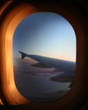Airplane window. Airplane wing viewed through the window Stock Images