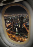 Airplane window. View from the airplane window, a modern city Stock Photos