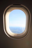 Airplane window. View through an airplane window royalty free stock photo